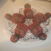 New_Spiders.jpg My little girl, 3 years old, helped me with these spiders. We made them from left overs of a spiderman cake. Once finished and she had a...
