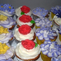 A Flower Garden  I made 100 cupcakes for a friend's niece's graduation. They wanted lots of flowers, some red, adn some with volleyballs. I love...