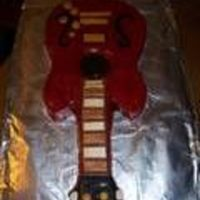 Guitar Cake Chocolate cake with chocolate filling and icing. Decorated with fondant and hand painted to look like my husband's weird guitar. Sorry...