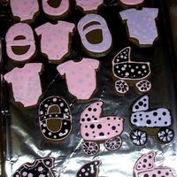 Baby Shower Cookies Chocolate sugar cookies with RI. These were very last minute and delivered still a little wet, but I'm happy with the black ones......