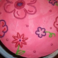 Hailey's Sparkly Flower Cake White cake with raspberry filling and faux fondant BC. The flowers were freehand and then I brushed shimmer dust over the top.