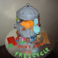Recycle Freecycle Dont bin, freecycle - garbage can cake with assorted items sticking out of it