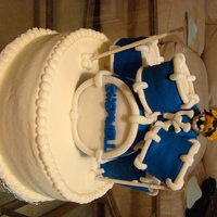 Uk Wildcat Playing Drums  This cake is for a University of Kentucky wildcat fan who plays the drums. Drums are rice krispy treats covered in fondant. Wildcat is...