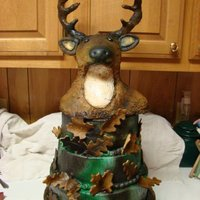 Three Tier Camouflage Buck Cake  Three tier airbrushed camouflage cake topped with a buck made of rice krispy treats covered in fondant then airbrushed. I was extremely...