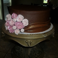 Roses And Fondant Sash This is iced in chocolate fudge buttercream. Roses are gumpaste, and the sash is brown fondant. I love this cake! I found it on here, but...