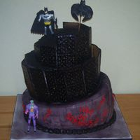 Batman Joker Cake Topsy Turvy cake made to look like Gothem City! Bottom tier is to look like wall made from fondant. Other tiers are buttercream with...