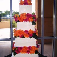 Fresh Flowers Buttercream Cake 4 tier wedding cake square buttercream with fresh roses inbetween. I love it!