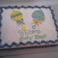 Rattles Made this cake for baby shower for someone at my mom's work. The rattles were free-hand and I like the yellow one much better than the...