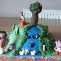 Dora Waterfall Cake  I made this for my daughter's second birthday. Unfortunately she loved it so much that she'd wrecked Dora and Boots before I was...