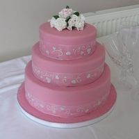 Pretty In Pink   Fondant iced with petal paste roses.TFL