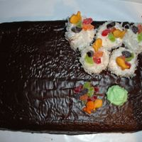 Sushi Coconut cake with twinkies wrapped in coconut shreds topped of with gummy candy. Thanks to all the members on CC who did this cake and gave...