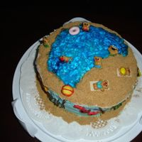 A Day At The Beach This cake was inspired by Woman's Day Magazine. I had colored gold fish and fruit roll ups as the sea weed all around the cake. There...