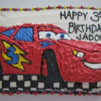 Disney Cars Birthday Cake  I used the Cars cake pan, and sliced the top off where the design baked- about 1/2 inch of cake. I baked a regular rectangle cake, and...