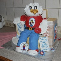 A School Mascot Sitting On A Chair Of Books! This cake was made for Teacher Appreciation Day. The school mascot is shown on the button near the eagles feet ... He was designed to look...