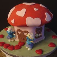 Smurfy I've been dying to make a smurf cake ... this is a replica of their mushroom house for Valentine's Day, with smurf figures made...