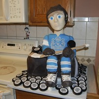 Bobble Head Hockey Cake For my son's end of year hockey banquet ... a hockey player sitting on top of his hockey bag! The head on the player actually bobbles...