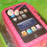 Ipod Cake Vanilla cake with chocoale buttercream filling. Fondant covering and details with black 'page' printed out onto edible paper,...