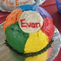 Evan's Smash Cake   used the sports ball pan and bc frosting for a beach ball smash cake