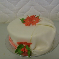 Merry Christmas Cake With Holly And Poinsettas This is a chocolate cake frosted with buttercream, and covered with fondant. The flowers and drape are also fondant. I also added some...