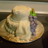 Grapes I made this for a friend who said she wanted a birthday cake that kinda looked like a wedding cake. It is covered with fondant. the...