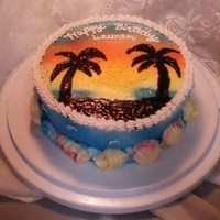 Hawiian Sunset With Palm Trees This is a chocolate cake with buttercream frosting. I made the sunset using wilton color spray, spraying around a palm tree stencile I made...