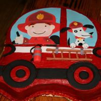 Firefighter Cake The cake is buttercream with fondant accents.