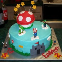 Super Mario Birthday! Vanilla cake with BC and fondant deco. The mom of the birthday boys found these perfect figures of the Mario characters. Mushroom is all...