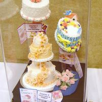 Wilton Instructor's Meeting July 2006 - First Place This is a cake display I made for the contest held at the Raleigh NC Wilton Method Instructors Annual Meeting. The contest rules said to...