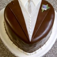 "Tuxedo Groom's Cake This was the groom's cake I made for my step-son's wedding. It was made from 2 heart shaped layers (10""x2"") split into..."