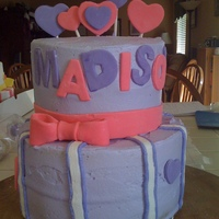 Madison's 6Th Birthday 2 tier caked frosted with butter cream and fondant decorations.