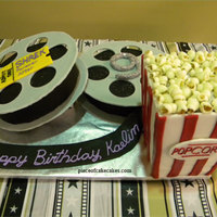 Movie Time the cake was the popcorn container and the inside of the movie reel. reels were gumpaste. popcorn was fondant.