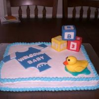 Baby Shower Cake   BC with fondant accents. baby blocks are make with rice crispy treats. ducky is all fondant & water is piping gel tinted blue.