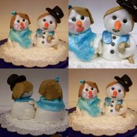 Mr. & Mrs. Snowman Another first I had a time getting Mr. Snowmans head to stay on... Body is wonder mold the heads are cupcakes.