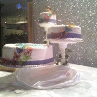 Wedding Cake And Grooms Cake cascading cake, fondant ribbon with butterlies