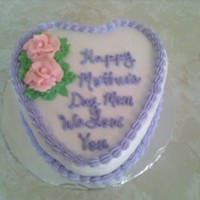 Happy Mother's Day lemon cake with buttercream. I am working on my handwriting, I do not like it. First time making rose on a stick, loved it! Much easier for...