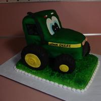 Johnnie Tractor #2 Did this cake for the Fulton County Fair. However, it didn't make it there. It shifted in the car and calapsed. I guess it was my own...