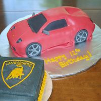 Lamborghini What a nightmare! My husband's great idea was to cover the cake in black fondant and then another layer of red fondant. He wanted to...