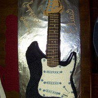Guitar Birthday replica of a young boys guitar all done in cake. the entire cake is piped in buttercream. The guitar strings are embroidery floss. The...