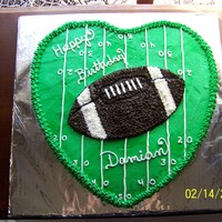 Football Birthday  birthday cake for a young man born on Valentine's day. Mom wanted a heart, he wanted football. I think I satisfied both. Cake is...