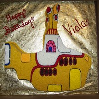 Yellow Submarine birthday cake of the Beatles Yellow Submarine. Sub was carved out of a sheet cake and covered entirely in buttercream using different size...