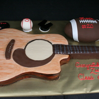 Graduation Cake- Love Of Music/sports   This cake was done as a graduation cake for a young man who had a love for music, and played football and baseball in school.