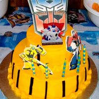 Transformer Cake My son requested a transformer cake for his High Five Birthday! Transformer cake, chocolate cake with orange buttercream. Edible images...