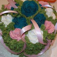 100_1018.jpg This was the top tier for a cupcake wedding cake. Enjoy