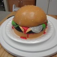 "Cheeseburger  This was made for a BBQ, top and bottom are vanilla cakewith the top made in a ball pan, the ""meat"" is a chocolate cake made into..."