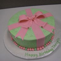 Green & Pink Cake Green & Pink Cake with buttercream icing and fondant accents.. strawberry shortcake with strawberry filing