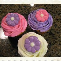 White Cupcakes With Chocolate Flower