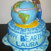 "A B The girl's long arms are giving the earth a massive hug in this b""earth""day cake. The earth is created from the Wilton sport..."