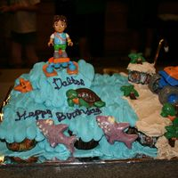 Diego Ccc CCC with 23 cupcakes. Diego and truck are toys, the animals and trees are candy melts.