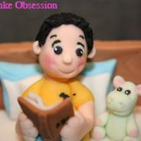 Little Boy And His Hippo Soft Toy Figurines are all made with fondant. The little hippo is only the height of 1 segment of my little pinkie!! :)