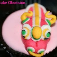 Lunar New Year Cupcake Lion Dance Head cupcake i did for a open house during Chinese New Year. Topper is made from fondant. Thanks for looking :)